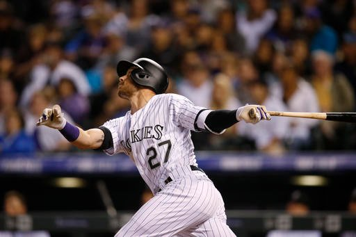 Colorado Rockies' Trevor Story flies out against the San Diego Padres in the fifth inning of a baseball game Saturday, April 9, 2016, in Denver. (AP Photo/David Zalubowski)