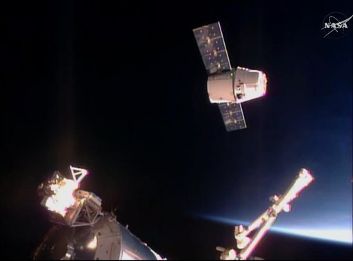 In this frame taken from video from NASA TV, the SpaceX Dragon cargo ship approaches the International Space Station, Sunday April 10, 2016. A SpaceX Dragon cargo ship arrived at the International Space Station on Sunday, two days after launching from Cap