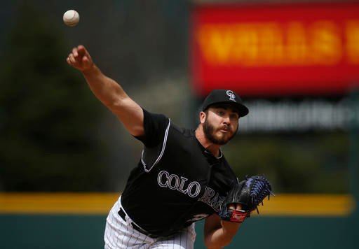 Colorado Rockies starting pitcher Chad Bettis delivers a pitch against the San Diego Padres in the first inning of a baseball game, Sunday, April 10, 2016, in Denver. (AP Photo/David Zalubowski)