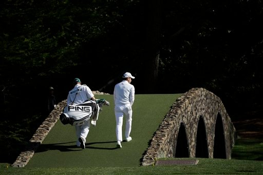 Danny Willett, of England, walks over the Hogan Bridge during the final round of the Masters golf tournament Sunday, April 10, 2016, in Augusta, Ga. (AP Photo/David J. Phillip)