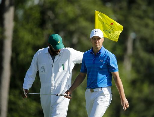 Jordan Spieth walks off the eighth green with his caddie Michael Greller during the final round of the Masters golf tournament Sunday, April 10, 2016, in Augusta, Ga. (AP Photo/Charlie Riedel)