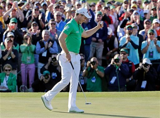 Danny Willett, of England, celebrates on the 18th hole after finishing the final round of the Masters golf tournament Sunday, April 10, 2016, in Augusta, Ga. (AP Photo/Charlie Riedel)