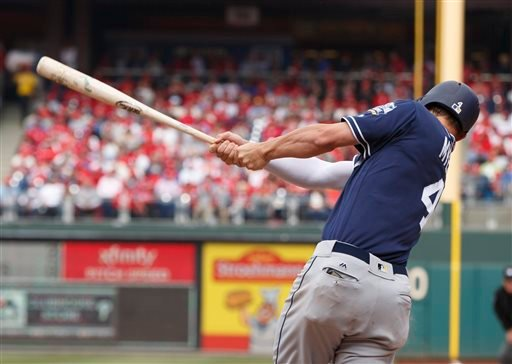 San Diego Padres' Wil Myers (4) hits a solo home run during the fourth inning of an opening day baseball game against the Philadelphia Phillies, Monday, April 11, 2016, in Philadelphia. (AP Photo/Chris Szagola)