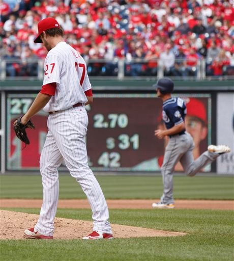 Philadelphia Phillies starting pitcher Aaron Nola (27) looks down as San Diego Padres' Wil Myers (4) rounds the bases after hitting a solo home run during the fourth inning of an opening day baseball game, Monday, April 11, 2016, in Philadelphia. (AP Phot