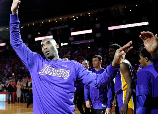 Los Angeles Lakers' Kobe Bryant acknowledges the crowd as he is introduced before an NBA basketball game against the Houston Rockets, Sunday, April 10, 2016, in Houston.