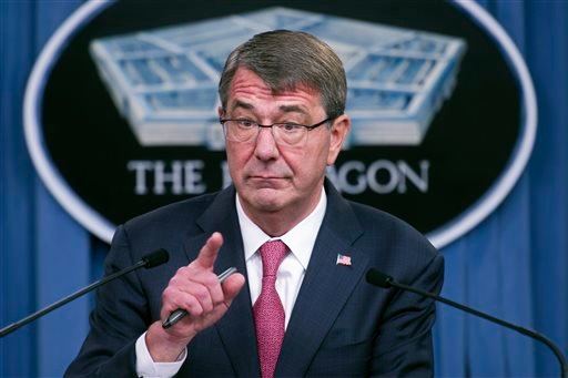 In this Dec. 3, 2015, file photo, Defense Secretary Ash Carter gestures during a news conference at the Pentagon to announce that he has ordered the military to open all combat jobs to women.