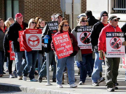 Striking Verizon workers picket outside a Verizon office on Wednesday, April 13, 2016, in Albany, N.Y. Verizon landline and cable workers on the East Coast walked off the job Wednesday morning after little progress in negotiations since their contract exp