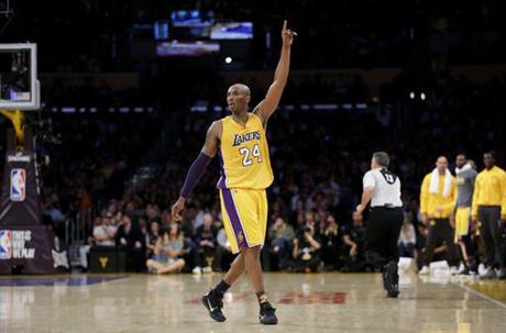 Los Angeles Lakers forward Kobe Bryant gestures during the first half of Bryant's last NBA basketball game, against the Utah Jazz, on Wednesday, April 13, 2016, in Los Angeles. (AP Photo/Jae C. Hong)