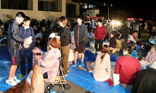 Stranded people gather outside a town hall of Mashiki, after an earthquake in Kumamoto, southern Japan, Thursday, April 14, 2016.