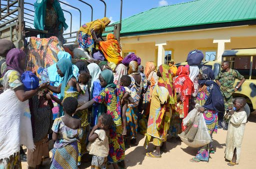 July 30, 2015, file photo: Women and children rescued by Nigerian soldiers from the Islamic extremist group Boko Haram in the northeast of Nigeria, arrive at the military office in Nigeria (AP Photo/Jossy Ola, File)