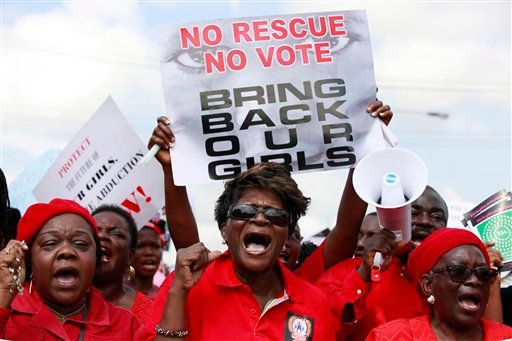 Monday, May 5, 2014 file photo: Women attend a demonstration in Lagos calling on the government to rescue kidnapped school girls of a government secondary school in Chibok, Nigeria. (AP Photo/ Sunday Alamba, File)