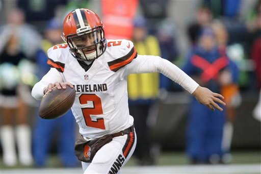In this Sunday, Dec. 20, 2015 file photo, Cleveland Browns quarterback Johnny Manziel looks to pass against the Seattle Seahawks in the second half of an NFL football game in Seattle.