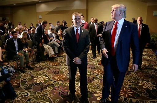 In this Aug. 25, 2015, file photo, Republican presidential candidate Donald Trump, right, walks with his campaign manager Corey Lewandowski after speaking at a news conference in Dubuque, Iowa. A Florida prosecutor's office plans to hold a news conference