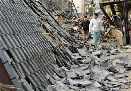 The powerful earthquake struck Thursday night, knocking down houses and buckling roads. (Ryosuke Uematsu/Kyodo News via AP)