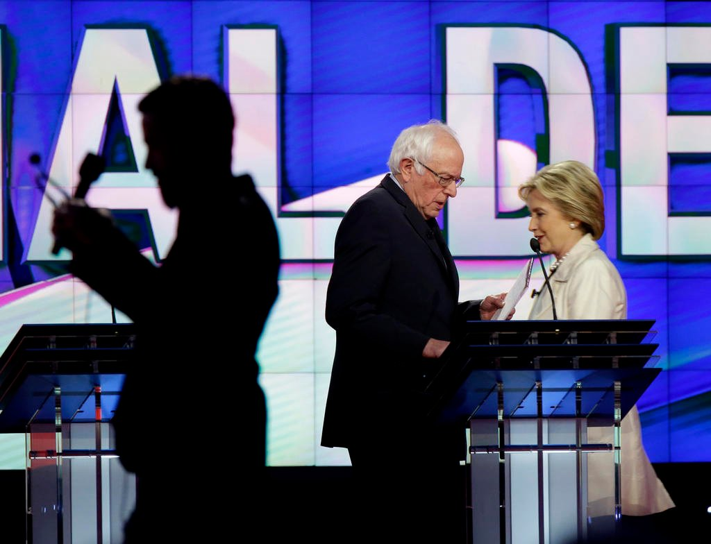Democratic presidential candidates Sen. Bernie Sanders, I-Vt., left, and Hillary Clinton pass during a break at the CNN Democratic Presidential Primary Debate at the Brooklyn Navy Yard on Thursday, April 14, 2016 in New York.