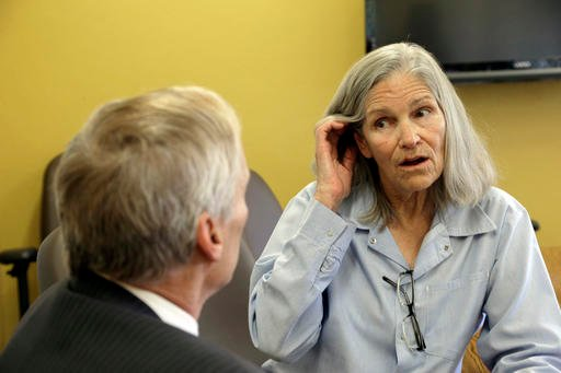 Former Charles Manson follower Leslie Van Houten confers with her attorney Rich Pfeiffer during a break from her hearing before the California Board of Parole Hearings at the California Institution for Women in Chino, Calif., Thursday, April 14, 2016.