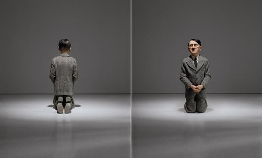 """This combination of undated photos provided by Christie's shows """"Him,"""" a controversial sculpture of Adolf Hitler by Maurizio Cattelan."""