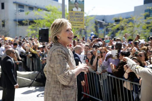 Democratic presidential candidate Hillary Clinton speaks to people in the overflow area during a campaign event at the Los Angeles Southwest College on Saturday, April 16, 2016, in Los Angeles.