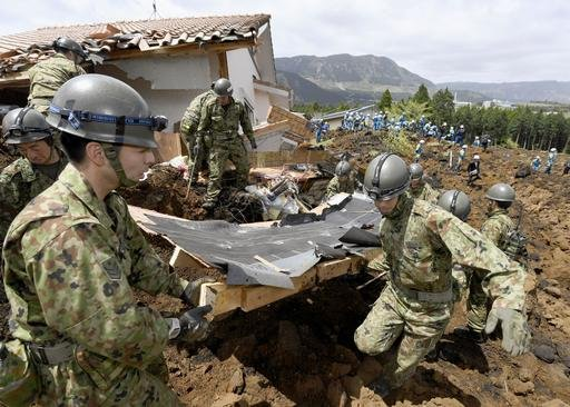 Japan Self-Defense Forces members conduct a search operation at the site of a landslide caused by an earthquake in Minamiaso, Kumamoto prefecture, Japan, Sunday, April 17, 2016. Two nights of increasingly terrifying earthquakes flattened houses and trigge