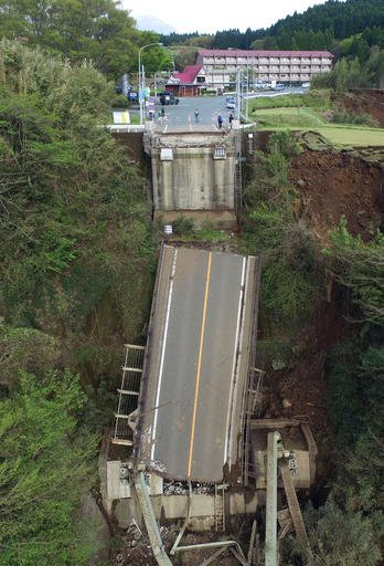 Aso Bridge is seen collapsed by a powerful earthquake in Minamiaso village, Kumamoto prefecture, Japan, Sunday, April 17, 2016. Two nights of increasingly terrifying earthquakes flattened houses and triggered major landslides in southern Japan. (Koji Hara