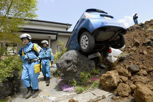 Police officers conduct a search operation at the site of a landslide caused by an earthquake in Minamiaso, Kumamoto prefecture, Japan, Sunday, April 17, 2016. Two nights of increasingly terrifying earthquakes flattened houses and triggered major landslid