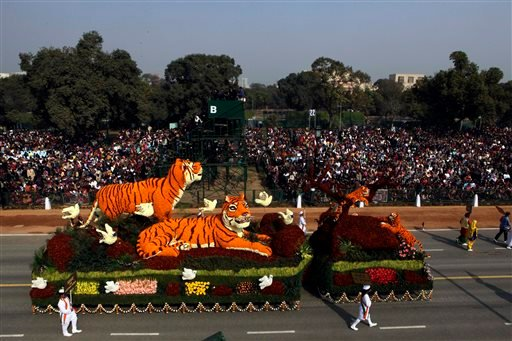 """In this Wednesday, Jan. 26, 2011, file photo, a floral tableau by Central Public Works Department depicts the theme """"Save Tigers"""" during the Republic Day parade in New Delhi, India. Countries with wild tiger populations have agreed to do more to protect t"""