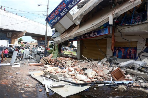 Rubble from a collapsed building lays on the ground in Tarqui, the business district of Manta, Ecuador, Sunday, April 17, 2016. A powerful, 7.8-magnitude earthquake shook Ecuador's central coast on Saturday, killing hundreds. (AP Photo/Patricio Ramos)