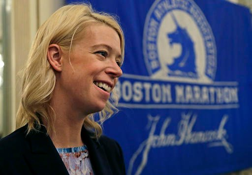 In this photo taken Thursday, April 14, 2016, Adrianne Haslet, a 2013 Boston Marathon survivor, speaks at a news conference, Thursday, April 14, 2016, in Boston. (AP Photo/Elise Amendola)
