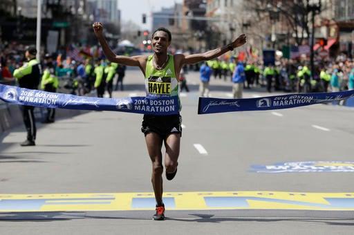 Lemi Berhanu Hayle, of Ethiopia, breaks the tape to win the 120th Boston Marathon on Monday, April 18, 2016, in Boston.