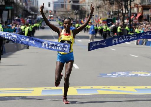 Atsede Baysa, of Ethiopia, breaks the tape to win the women's division of the 120th Boston Marathon on Monday, April 18, 2016, in Boston.