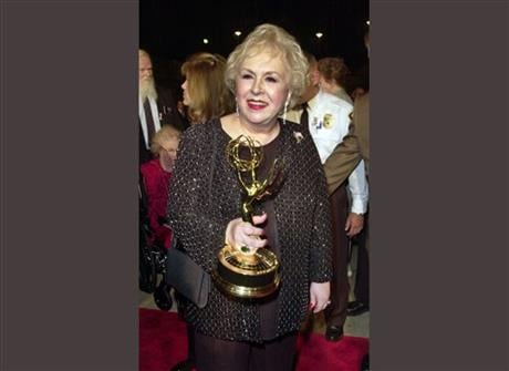 """Doris Roberts holds her Emmy for outstanding supporting actress in a comedy series for her work on """"Everybody Loves Raymond"""" following the 53rd annual Primetime Emmy Awards in Los Angeles. AP"""