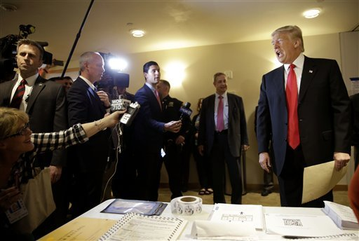 Republican presidential candidate Donald Trump talks to reporters while voting in New York, Tuesday, April 19, 2016.