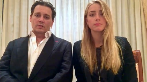 In this image made from video released by the Australian Government Department of Agriculture and Water Resources on Monday, April 18, 2016, actor Johnny Depp and his wife, Amber Heard speak in a videotaped apology.