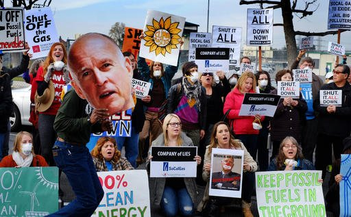 In this Jan. 16, 2016, file photo, protestors carry a photo of Gov. Jerry Brown and demand a shut down of the Southern California Gas Company's Aliso Canyon Storage Facility near Porter Ranch in Los Angeles.