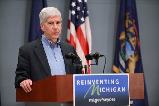 Gov. Rick Snyder speaks to the press on Wednesday, April 20, 2016 in Lansing, Mich. Months after officials conceded that a series of bad decisions had caused a disaster, charges were filed against a pair of state Department of Environmental Quality employ