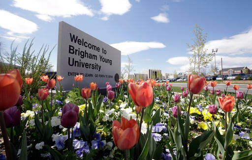 In this Tuesday, April 19, 2016, a welcome sign to Brigham Young University sits at the school in Provo, Utah. BYU students who say they were sexually assaulted are finding themselves under investigation for possible violations of the Mormon school's code