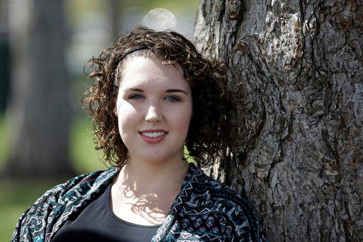 In this April 19, 2016 photo, Madeline MacDonald poses for a photograph, in Provo, Utah. MacDonald said she reported being sexually assaulted during her freshman year at Brigham Young University. She is among other students who say they have been sexually