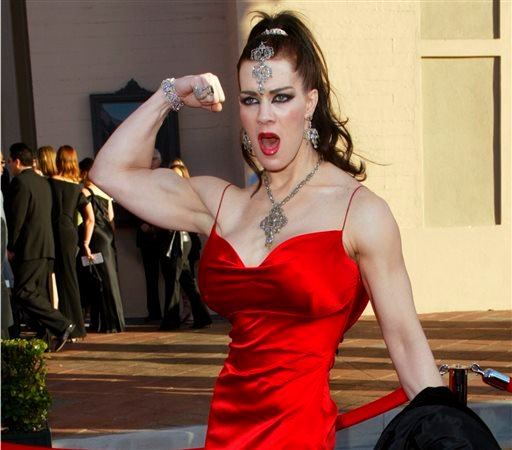 FILE - In this Nov. 16, 2003 file photo, Joanie Laurer, former pro wrestler known as Chyna, flexes her bicep as she arrives at the 31st annual American Music Awards, in Los Angeles.