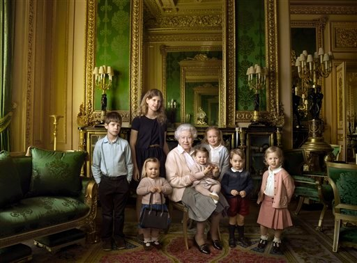 This official photograph, released by Buckingham Palace on Wednesday April 20, 2016, to mark her 90th birthday, shows Queen Elizabeth II with her five great-grandchildren and her two youngest grandchildren.