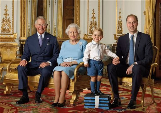 In this image released by the Royal Mail on Wednesday April 20, 2016, Britain's Prince George stands on foam blocks during a photo shoot for the Royal Mail in the summer of 2015 in the White Drawing Room at Buckingham Palace in London.