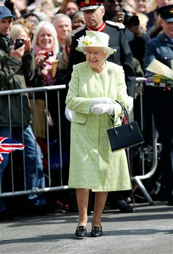 Britain's Queen Elizabeth II meets well wishers during a walkabout to celebrate her 90th birthday in Windsor, England, Thursday April 21, 2016.