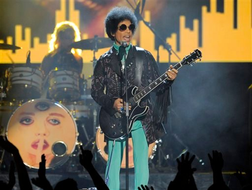 In this May 19, 2013 file photo, Prince performs at the Billboard Music Awards at the MGM Grand Garden Arena in Las Vegas.