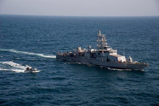 In this photo released by the U.S. Navy on Feb. 21, 2014, a rigid hull inflatable boat transits alongside the coastal patrol ship USS Typhoon during a vertical onboard deliver exercise in the Arabian Gulf. A U.S. Navy investigative report obtained by The