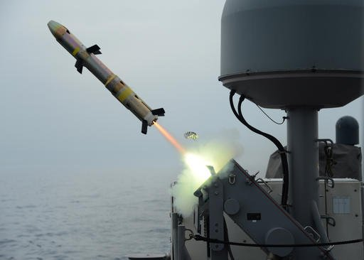 In this photo released on March 20, 2014 by the U.S. Navy, patrol coastal ship USS Typhoon launches a surface-to-surface missile during Griffin missile exercise to guard against small boat threats in the U.S. 5th Fleet Area of responsibility. A U.S. Navy