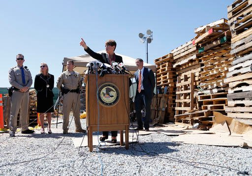 U.S. Attorney Laura Duffy speaks during a news conference in a lot alongside the border with Mexico Wednesday, April 20, 2016, in San Diego. A nearly half-mile-long tunnel leading from Mexico to San Diego was discovered and more than a ton of cocaine and