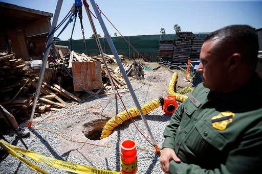 Border Patrol Special Operations Supervisor Cesar Sotelo looks on in front of the entrance to a tunnel leading to Mexico from a lot along the border, Wednesday, April 20, 2016, in San Diego. Officials announced the recent discovery of the nearly half-mile
