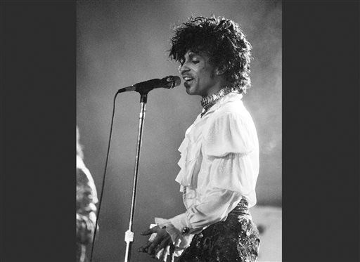 FILE - In this April 7, 1985 file photo, Prince performs at the Orange Bowl during his Purple Rain tour in Miami.