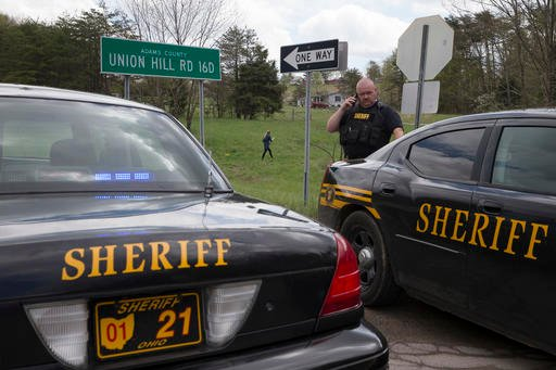 Authorities create a perimeter near a crime scene on Union Hill Rd, Friday, April 22, 2016, in Pike County, Ohio.