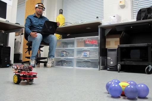 In this April 15, 2016 photo, University of Florida PhD student Islam Badreldin, 31, practices driving a brain-controlled vehicle that he modified to work wirelessly in Gainesville, Fla.