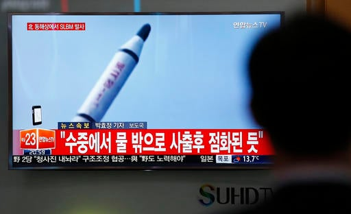 A man watches a TV news program showing a file footage of a missile launch conducted by North Korea, at the Seoul Train Station in Seoul, South Korea, Saturday, April 23, 2016.
